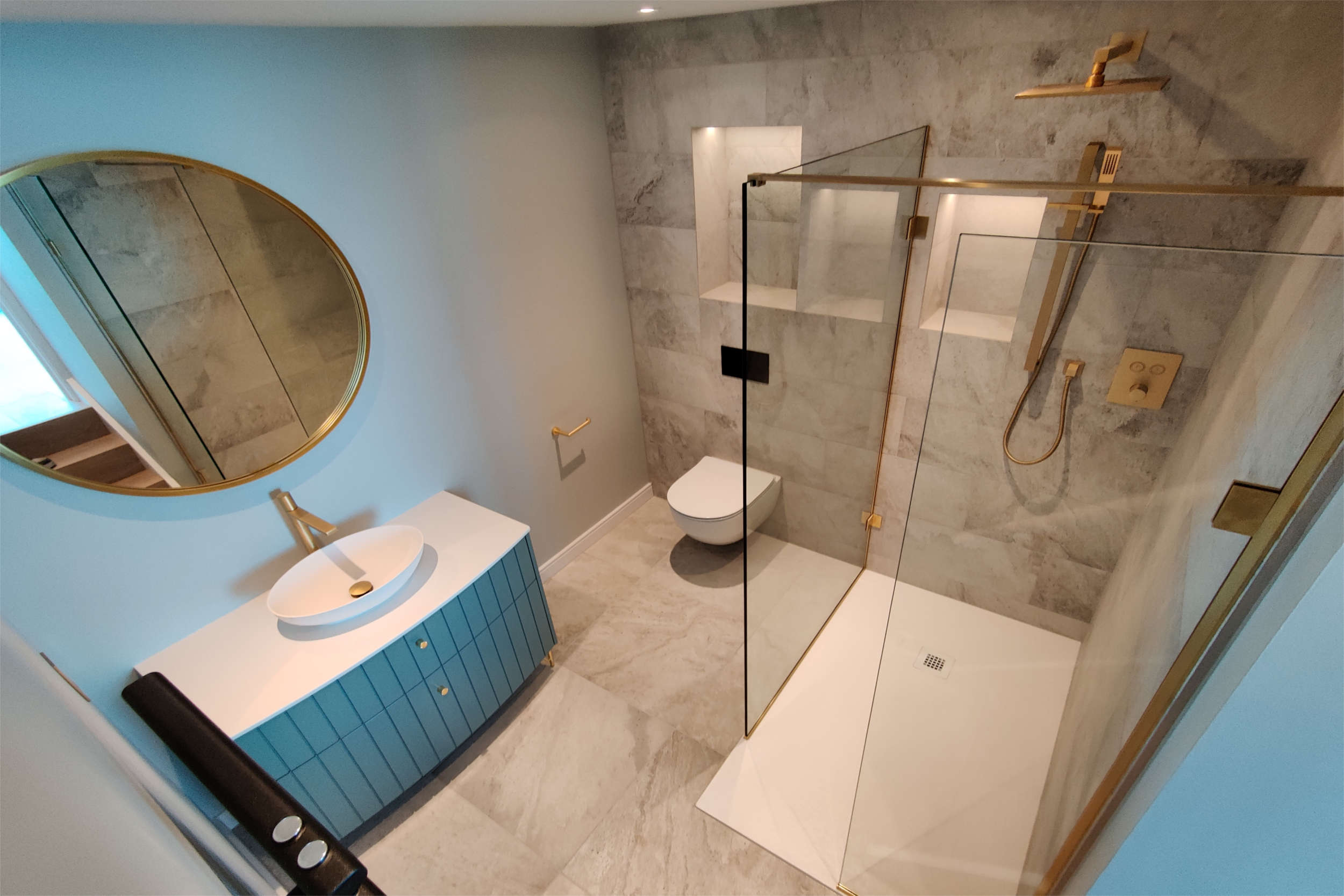 Modern ensuite with brass fittings